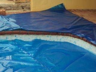 Step 5:Ensure that the pool cover remains evenly placed over the pool.